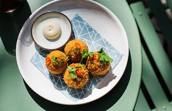 XO arancini, part of the new brunch menu at Potts Point eatery Paper Bird.
