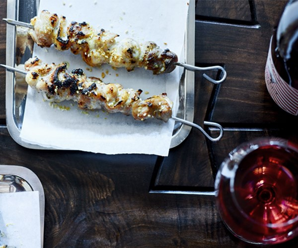 Grilled chicken sticks in chicken fat and sesame