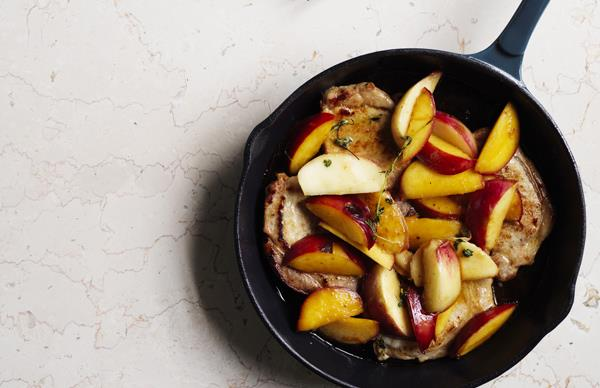 Pork medallions with nectarines and potato salad