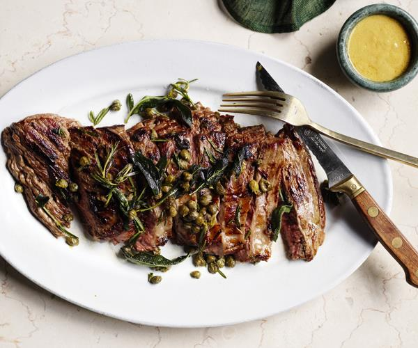 Flank steak with mustard sauce, herbs and capers