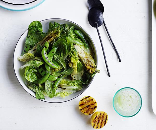 Charred lettuce and pea salad with charred lemon dressing