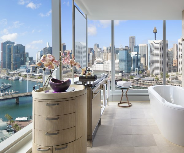 The bathroom in the Luxury room has views out to Darling Harbour view.