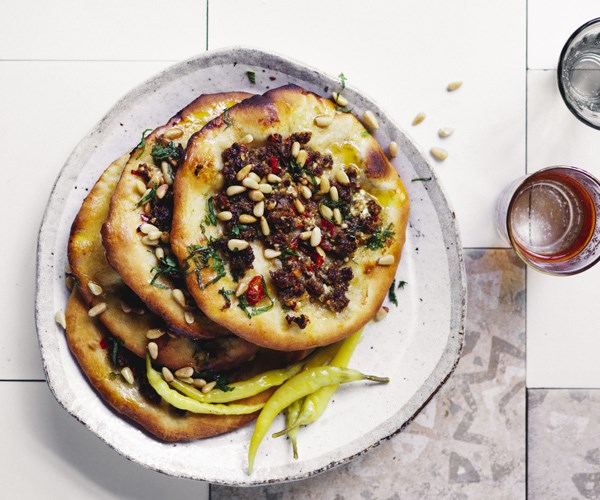 Turkish-style bread topped with lamb, spices and pine nuts