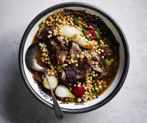 "**[Greg Maloug's baharat lamb shoulder with onions and moghrabieh](https://www.gourmettraveller.com.au/recipes/browse-all/baharat-lamb-shoulder-with-onions-and-moghrabieh-16260|target=""_blank""