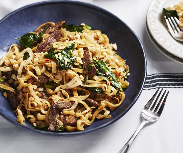 Stir-fried beef and gai lan with rice noodles
