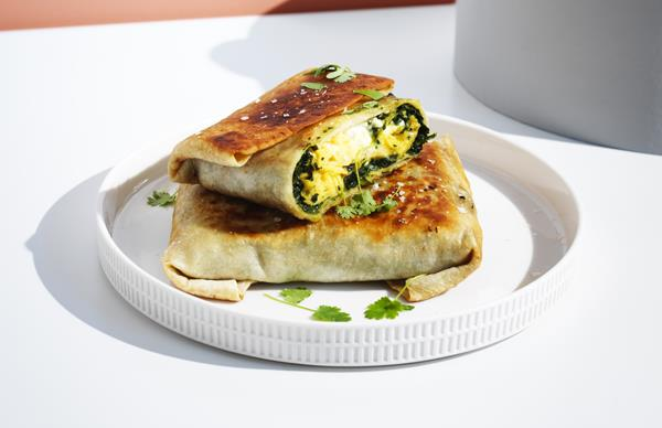 Egg and Indian-spiced creamed silverbeet wraps