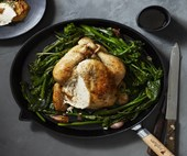Roast chicken with anchovy butter and greens