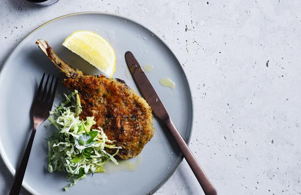 Veal cotoletta with cabbage, mint, apple and dill
