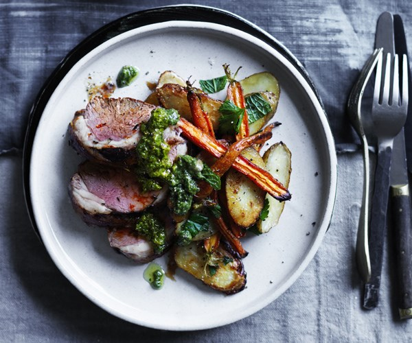 Mini lamb roast with baby carrots, kipflers and carrot-top pesto