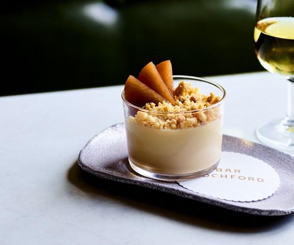 Hay panna cotta with chamomile pears and malt crumb