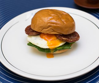 Occhio di bue - fried egg and cotechino on a milk bun at Matteo Downtown