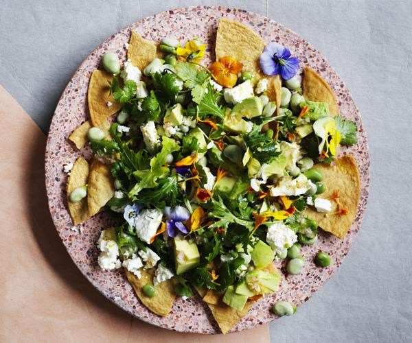 Fried tortillas with broad beans, feta and lime
