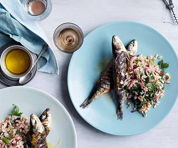 Char-grilled vine-leaf sardines with brown rice, pine nuts and barberries