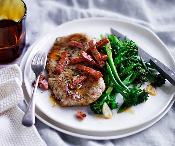 Pork schnitzel with broccolini and sopressa