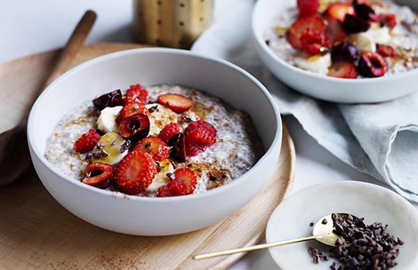 Almond milk Bircher muesli with banana, berries and cacao nibs