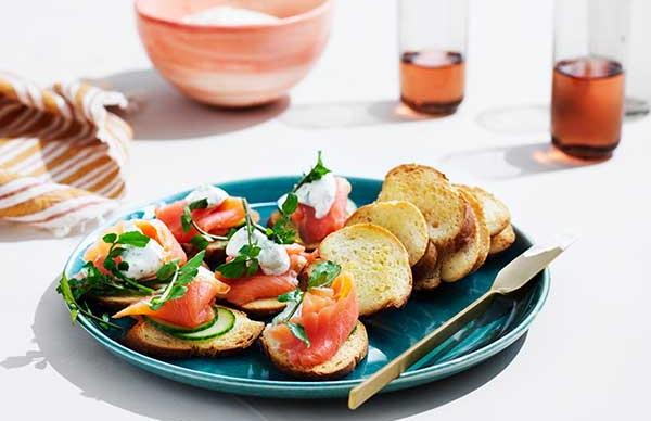 Crostini with smoked trout, dill crème fraîche and cucumber