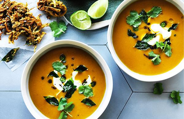 Spiced pumpkin soup with onion bhajis and curry leaves