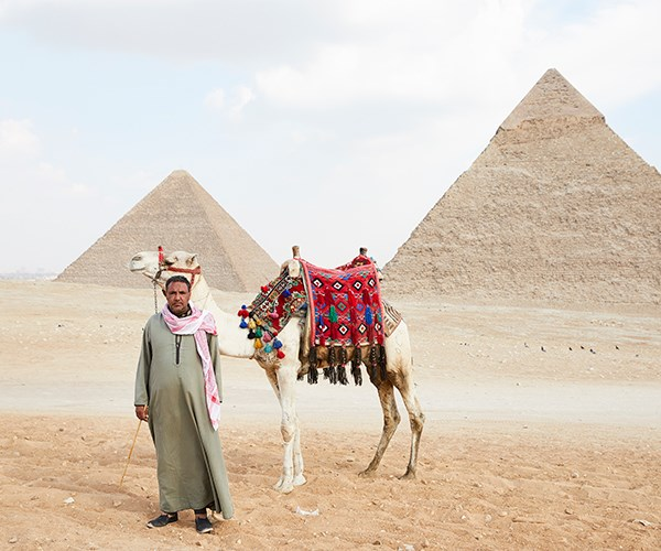 Camel man Hisham Gabri with his charge, Captain Cook, in Giza.
