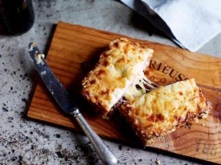 Croque-monsieur with smoked ham, cheese and smoked sausage