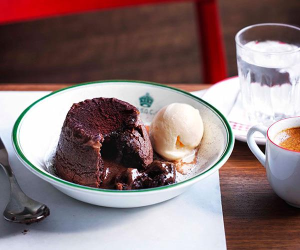 Soft-centred chocolate budini with milk ice-cream