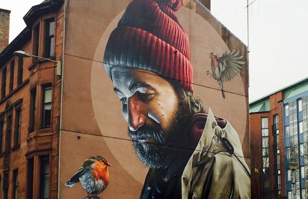 High Street mural of Saint Mungo by Sam Bates, aka Smug.