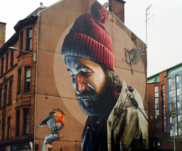 High Street mural of Saint Mungo by Sam Bates, aka Smug.