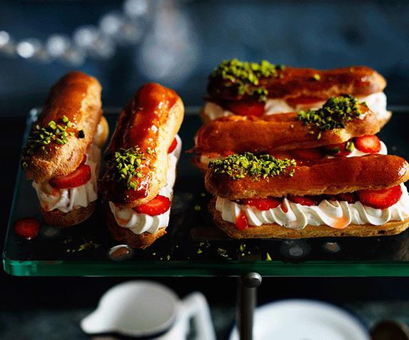"""**[Crushed strawberry and pistachio éclairs](https://www.gourmettraveller.com.au/recipes/browse-all/crushed-strawberry-and-pistachio-eclairs-12606