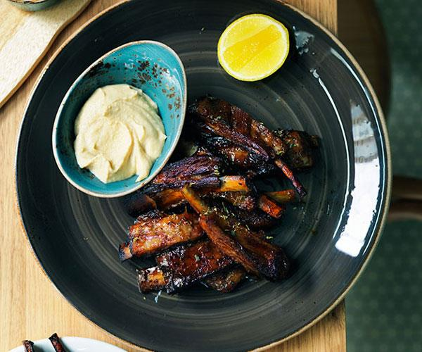 Slow-roasted lamb spare ribs with thyme honey and ouzo glaze