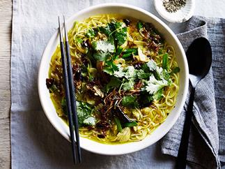 Fragrant chicken noodle soup with turmeric, ginger and chilli