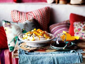 Golden pavlova with mango yoghurt and tropical fruits