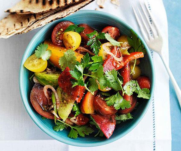 """**[Mixed tomato salad with sumac, herbs and flatbread](https://www.gourmettraveller.com.au/recipes/browse-all/mixed-tomato-salad-with-sumac-herbs-and-flatbread-10335
