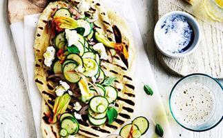 Speedy yoghurt flatbread with zucchini flowers and feta