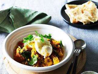 Breakfast curry with roti and poached egg