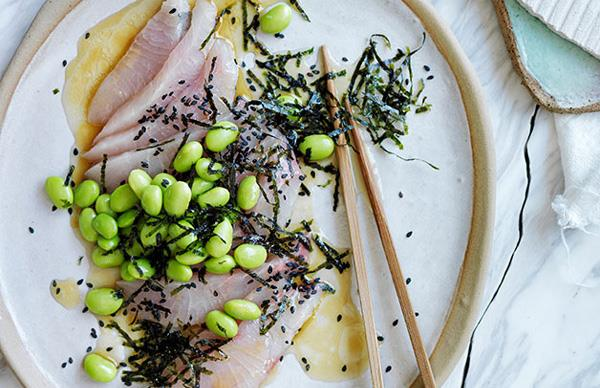 Sashimi of mulloway with a sesame-citrus dressing, edamame and seaweed