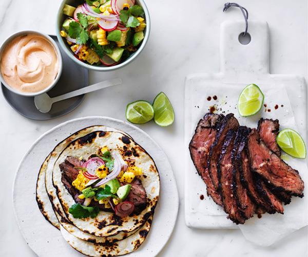 Flank steak tacos with corn, avocado and coriander