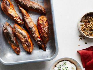 Baked sweet potatoes with goat's cheese topping