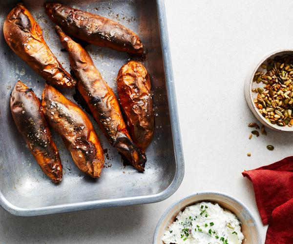 """**[Baked sweet potatoes with goat's cheese topping](https://www.gourmettraveller.com.au/recipes/fast-recipes/baked-sweet-potatoes-17851