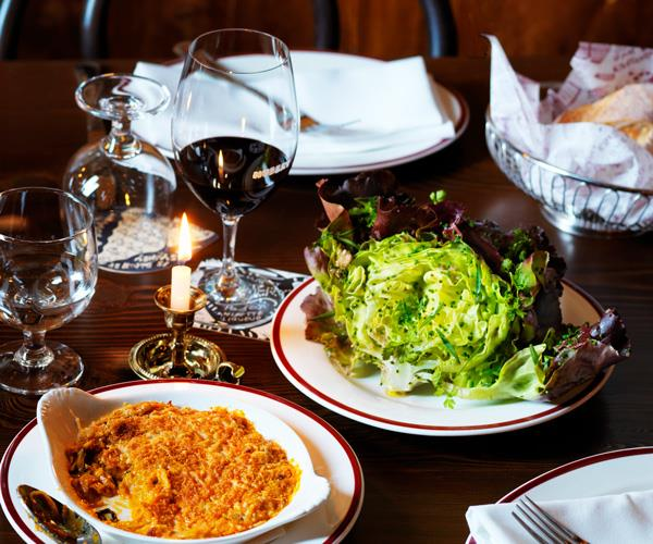 L-R Restaurant Hubert's kimchi gratin & red butter lettuce with caper and anchovy vinaigrette