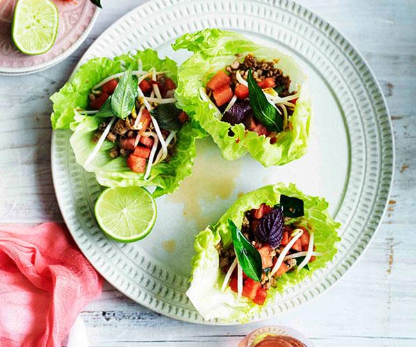 Pork in lettuce cups with watermelon and bean sprouts