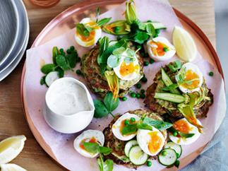 Pea, zucchini and mint fritters with eggs and feta sauce