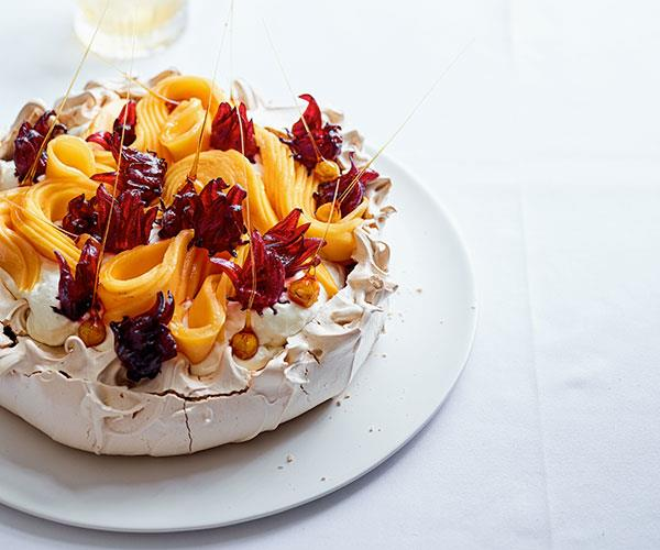 "**[Lauren Eldridge's brown-sugar pavlova with mango, hibiscus, hazelnut and coconut cream](https://www.gourmettraveller.com.au/recipes/chefs-recipes/brown-sugar-pavlova-18042|target=""_blank"")**"