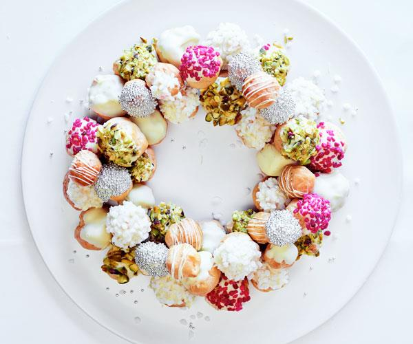 "**[Lauren Eldridge's white chocolate and pistachio profiterole wreath](https://www.gourmettraveller.com.au/recipes/chefs-recipes/profiterole-wreath-18040|target=""_blank"")**"