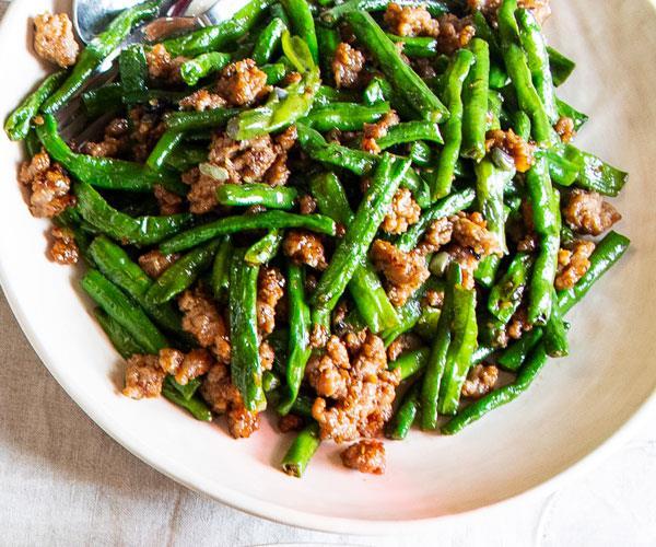 "**[Louis Tikaram's stir-fried snake beans with pork](https://www.gourmettraveller.com.au/recipes/chefs-recipes/stir-fried-beans-pork-18201|target=""_blank"")**"