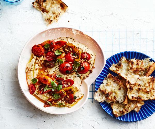 "**[Hummus with blistered tomatoes](https://www.gourmettraveller.com.au/recipes/fast-recipes/hummus-tomatoes-18241|target=""_blank"")**"