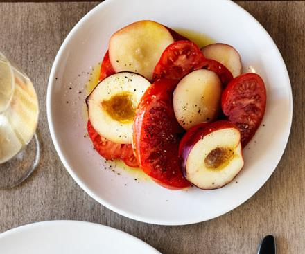 """**[Saint Peter's oxheart tomato and white peach salad](https://www.gourmettraveller.com.au/recipes/chefs-recipes/saint-peters-oxheart-tomato-and-white-peach-salad-8567