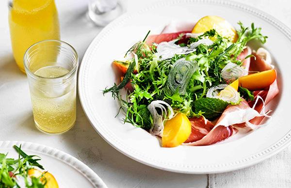 Herb salad with peaches and prosciutto
