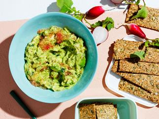 Buckwheat-hemp crackers with avocado and finger lime