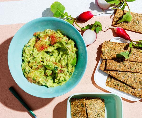 Buckwheat-hemp crackers with avocado and finger lime