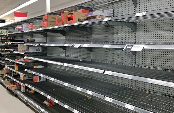 Empty supermarket shelves as a result of panic-buying triggered by COVID-19 fears.