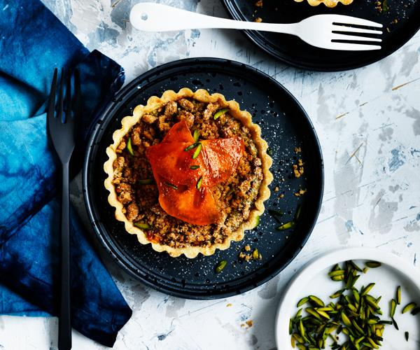 """**[Persimmon, pistachio and ginger crumble tarts](https://www.gourmettraveller.com.au/recipes/chefs-recipes/persimmon-pistachio-and-ginger-crumble-tarts-8439